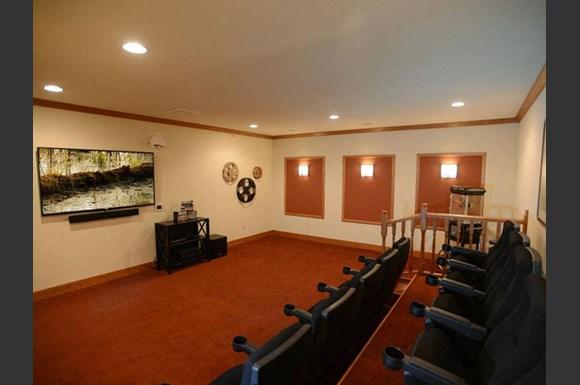 Media Room With Large Screens at Highlands at Riverwalk Apartments 55+, 10954 N Cedarburg Road