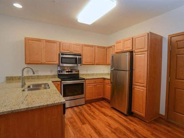 Gourmet Kitchens with Dishwasher and Disposal at Highlands at Riverwalk Apartments 55+, Mequon, WI,53092