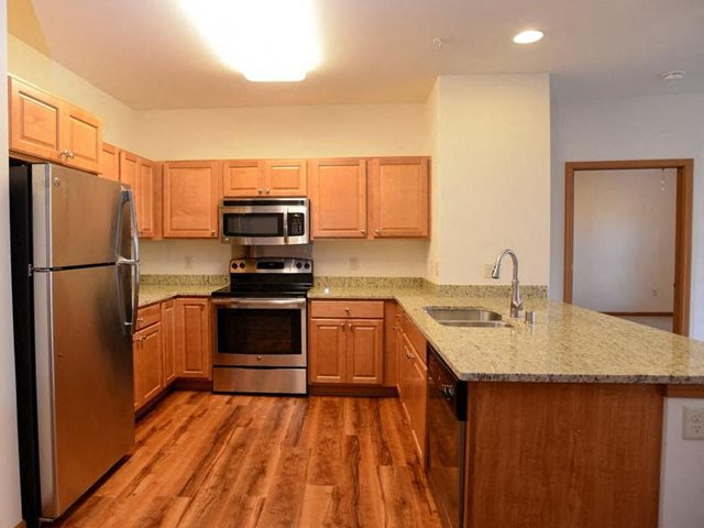 Gourmet Kitchens with Islands, Caesarstone Countertops, and Decorative Backsplash at Highlands at Riverwalk Apartments 55+, Mequon, 53092