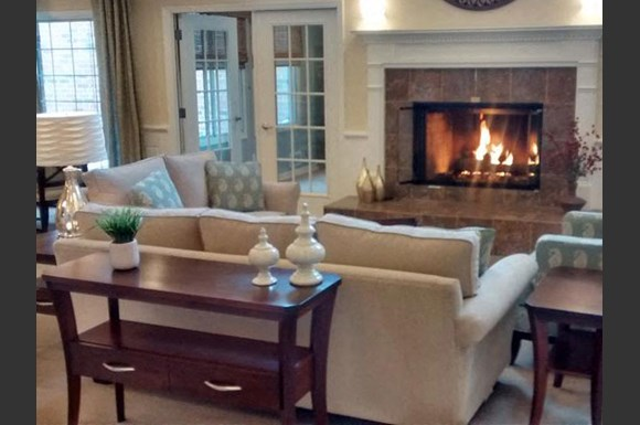 Living Rooms With Fireplace at Brookfield Highlands Apartments 55+, 20825 George Hunt Circle, 53186