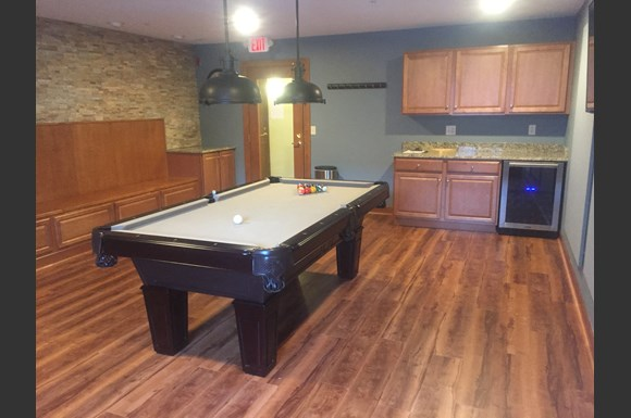 Clubhouse with Billiards, Darts, Bar & Lounge at Wildwood Highlands Apartments & Townhomes 55+, N78w17445 Wildwood Drive, Menomonee Falls, WI 53051