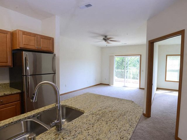 Living Room With Attached Balcony at The Highlands at Mahler Park Apartments 55+, Neenah, 54956