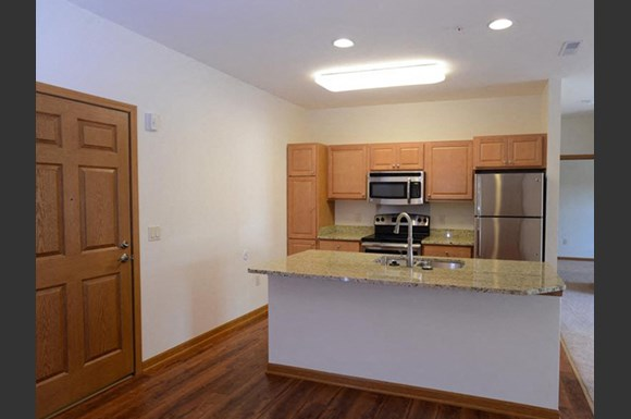 Gourmet Kitchens with Islands, Caesarstone Countertops, and Decorative Backsplash at The Highlands at Mahler Park Apartments 55+, Wisconsin