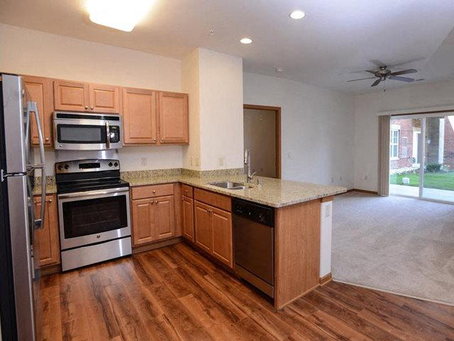 Spacious Kitchen with Pantry Cabinet at The Highlands at Mahler Park Apartments 55+, Neenah, WI,54956