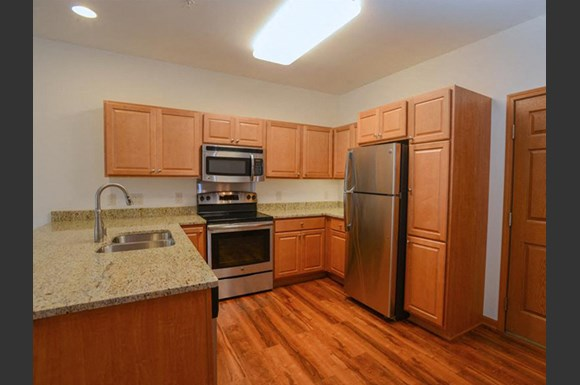 Fully equipped kitchen with Over-the-Range Microwavesat The Highlands at Mahler Park Apartments 55+, Neenah, Wisconsin, 54956