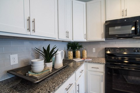 Kitchen With White Cabinetry And Appliances at Meridian at Fairfield Park, North Carolina, 28412