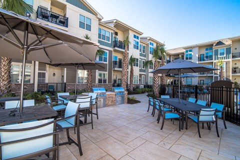 Courtyard Sitting With Umbrella Shades at Meridian at Fairfield Park, Wilmington, NC, 28412