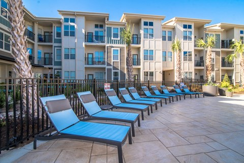 Poolside Sundeck With Relaxing Chairs at Meridian at Fairfield Park, Wilmington, 28412