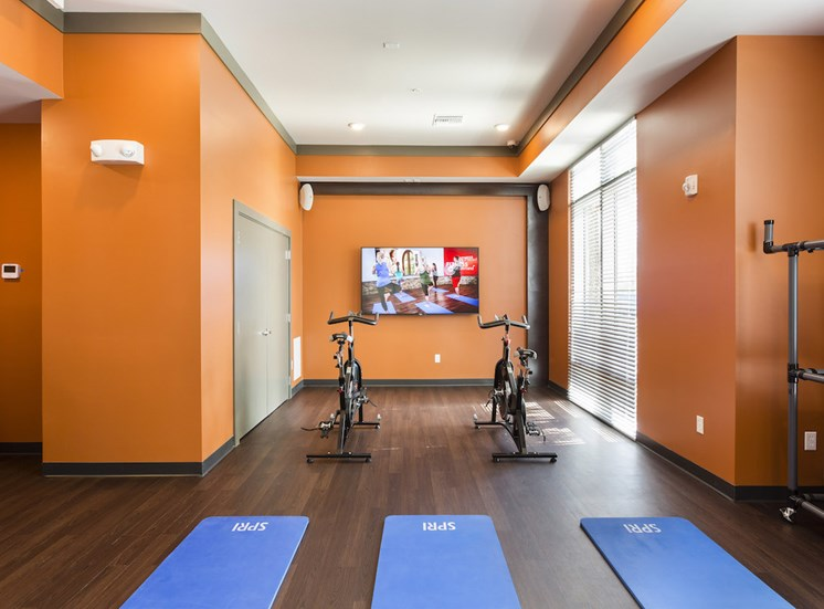 cardio center with yoga mats and spin bikes