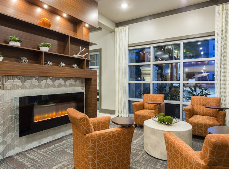 fireplace and seating by pool window in resident lounge