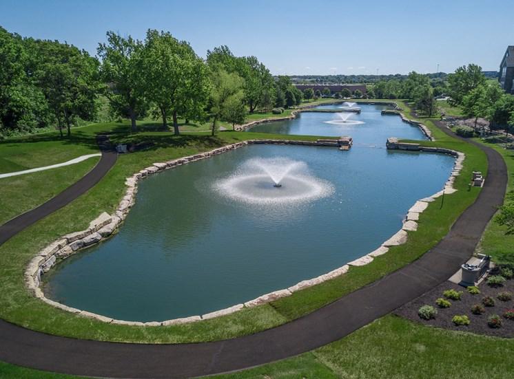 Lenexa KS Apartments-Waterside Residences at Quivira Apartments Neighboring Lake With Fountain And Surrounding Greenery