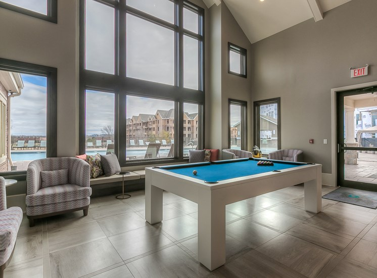 Apartments for Rent in Lenexa KS-Waterside Residences at Quivira Apartments Resident Clubhouse With Billiards Table And Large Windows