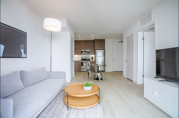 Santa Monica Luxury Apartment 1427 7th living area with hardwood style floors and gray couch