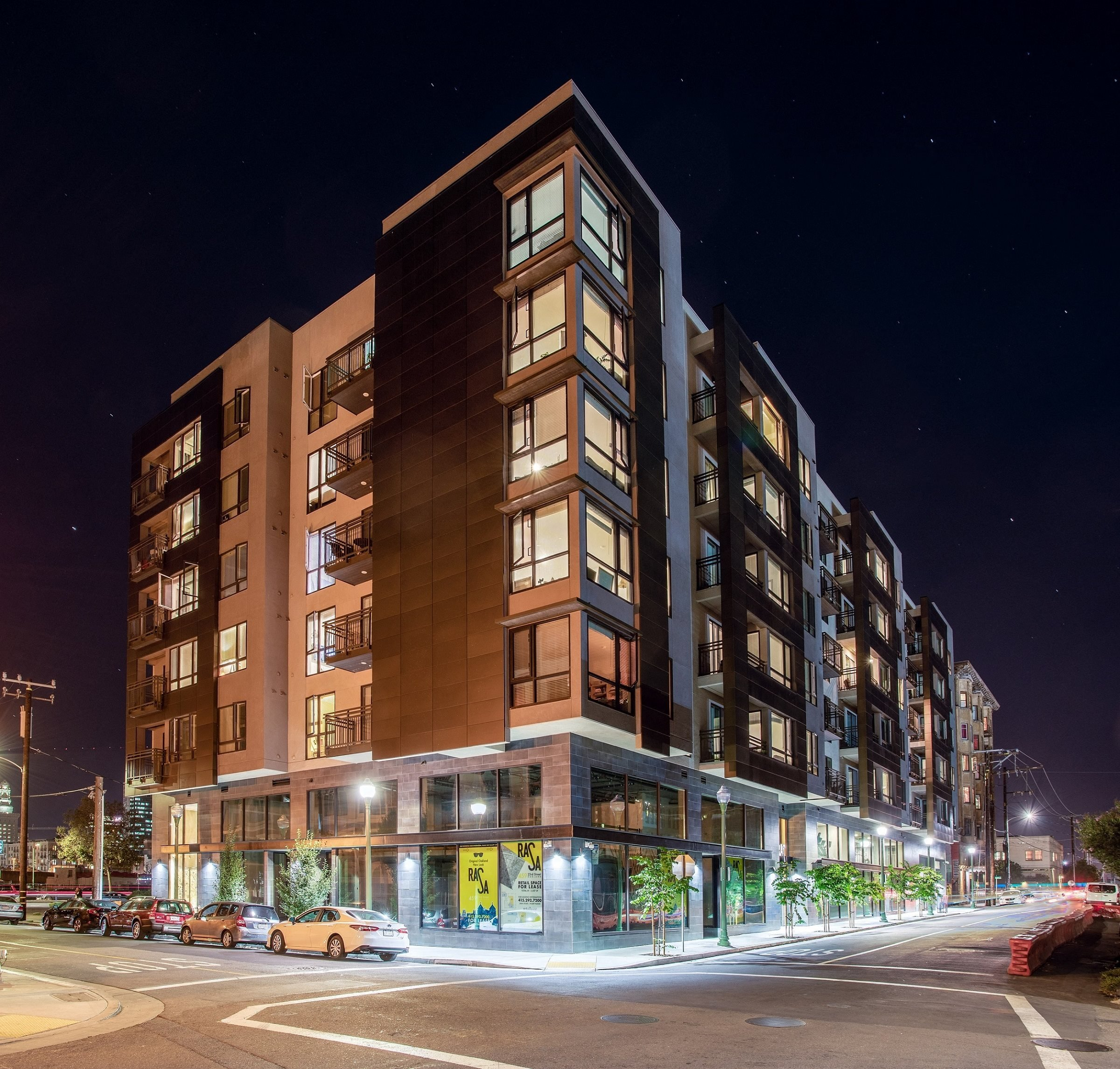 Luxury Apartments in Oakland CA - Exterior View of the Apartment Building at Night Showcasing Expansive Community