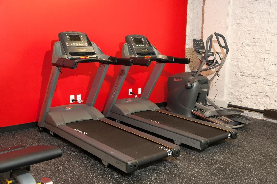 The Cameron Fitness Room with Elliptical and Treadmill Machines