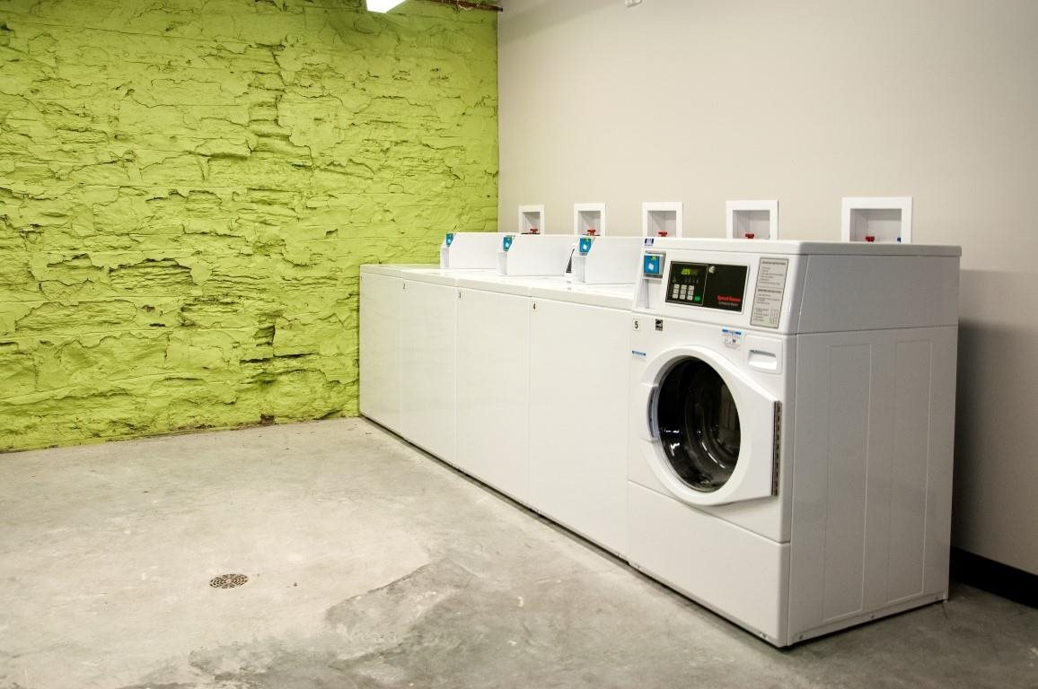 The Cameron North Loop Laundry Room with Multiple Washing Mashines