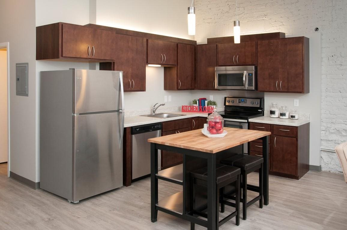Large Kitchen with Stainless Steel Appliances and Dark Wood Cabinetry