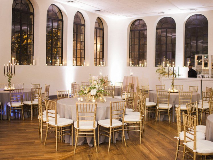 Ballroom with large windows and reception tables