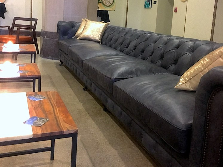 large grey couch in lounge at TJ Tower