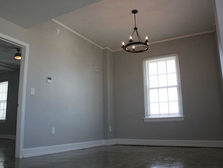 Soft grey walls and hanging chandelier in Thomas Jefferson Tower Apartment