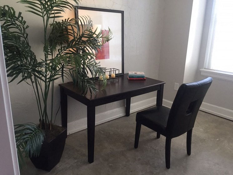 Home office with desk and chair in apartment
