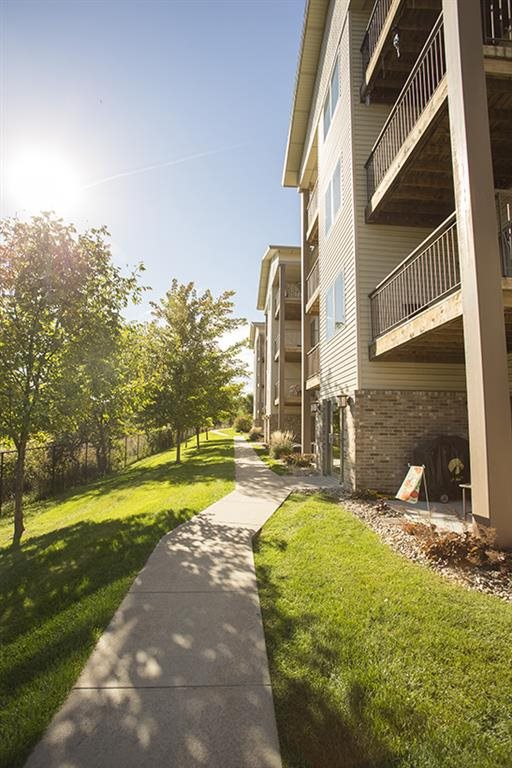 exterior side with walking path at Grand Legacy in Omaha Nebraska
