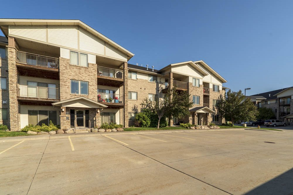 Flats-style building with balconies at Grand Legacy apartments and townhomes in west Omaha NE 68130