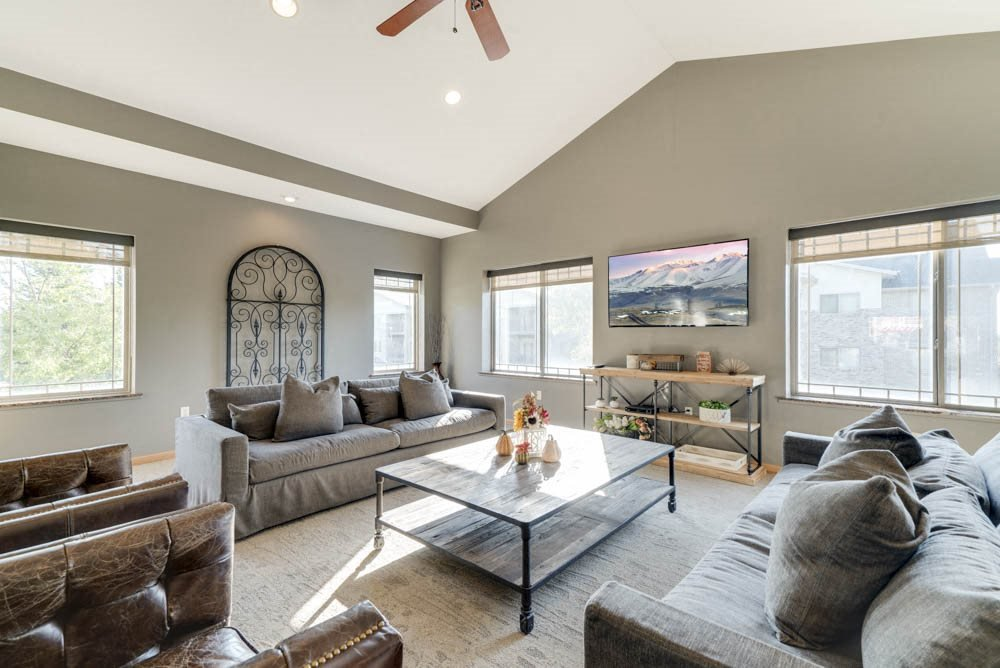 Renovated clubhouse with couches and TV  at Grand Legacy apartments and townhomes in west Omaha NE 68130