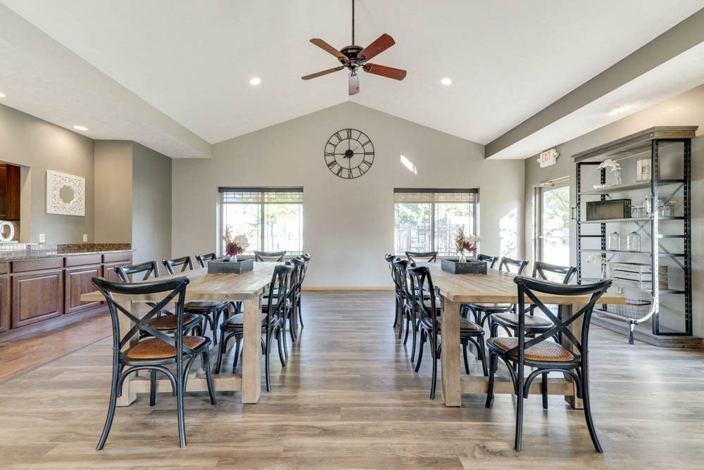 Renovated clubhouse with tables for residents  at Grand Legacy apartments and townhomes in west Omaha NE 68130