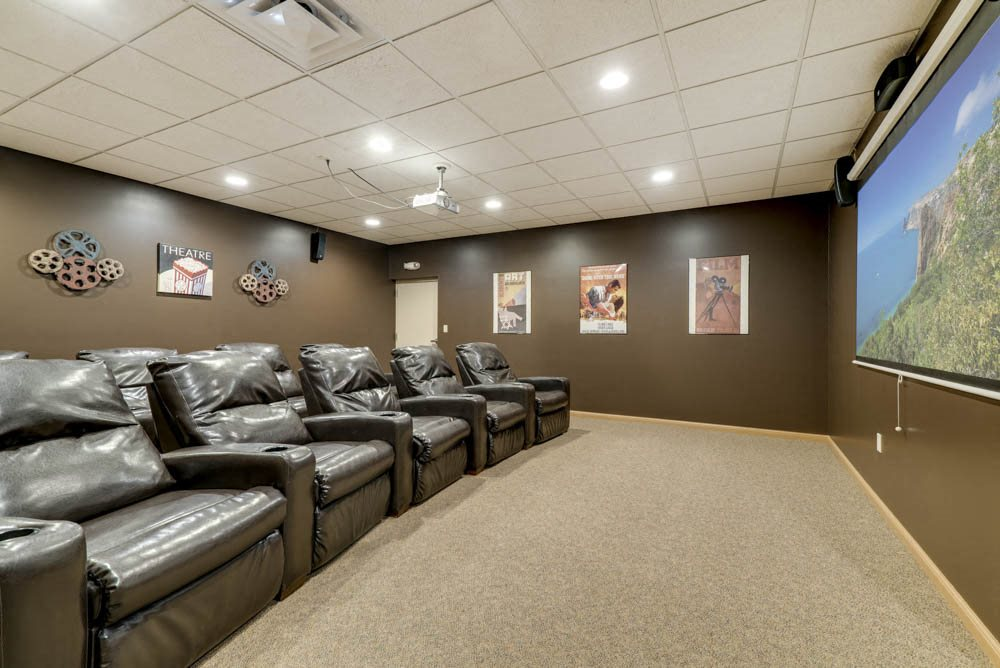Theater room with theater seats  at Grand Legacy apartments and townhomes in west Omaha NE 68130