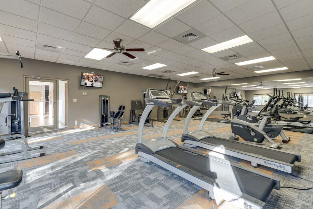 Large 24-hour fitness center with treadmills and weightlifting machines  at Grand Legacy apartments and townhomes in west Omaha NE 68130