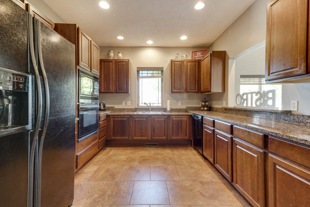 Full kitchen for residents to use in clubhouse  at Grand Legacy apartments and townhomes in west Omaha NE 68130