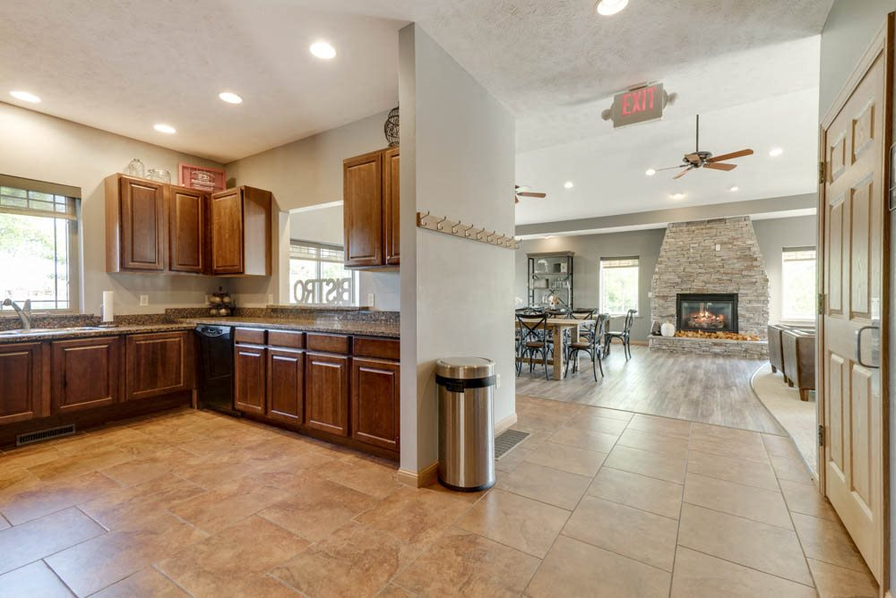 Kitchen and great room in clubhouse  at Grand Legacy apartments and townhomes in west Omaha NE 68130