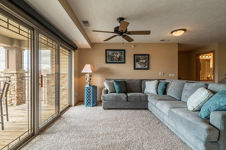 Large living room big enough to fit a sectional couch at Grand Legacy Apartments