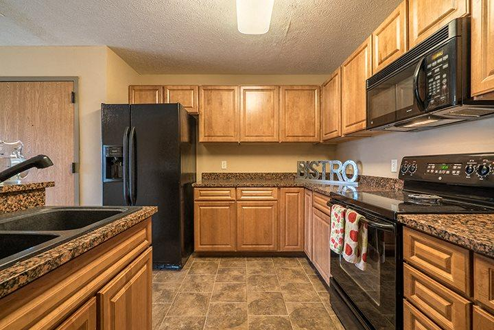 Large open concept kitchen with updated appliances at Grand Legacy Apartments