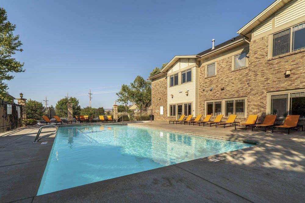 View of clubhouse with swimming pool  at Grand Legacy apartments and townhomes in west Omaha NE 68130