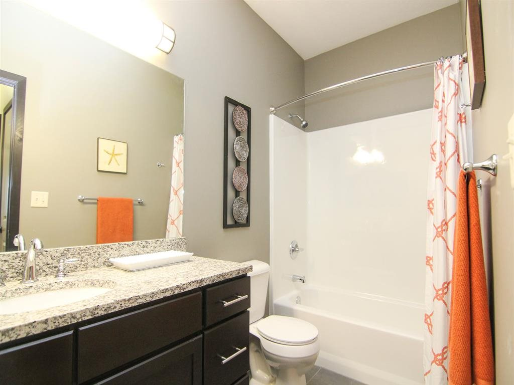 Bathroom with curved shower rod at The Flats at 84 in southeast Lincoln NE 68516