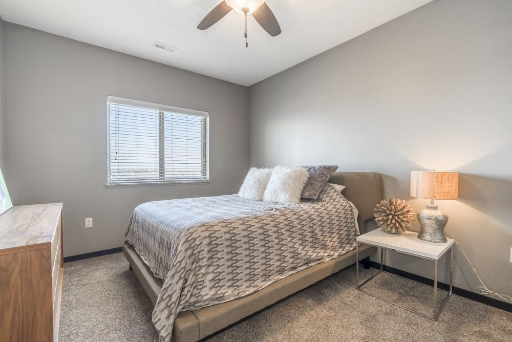 Living room with ceiling fan at The Flats at 84 in southeast Lincoln NE 68516