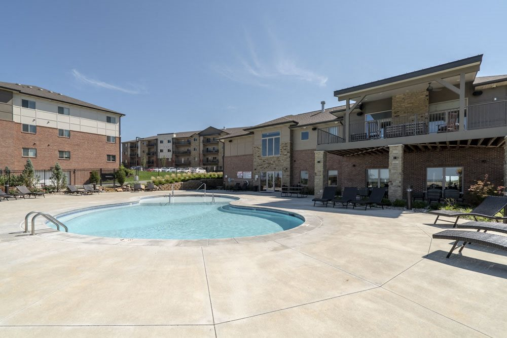 Resort-style pool and hot tub at The Flats at 84 in southeast Lincoln NE 68516