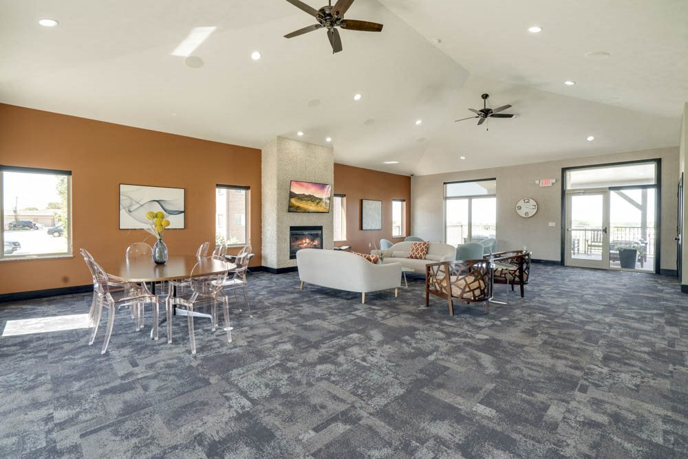 Clubhouse with TV lounge and seating at The Flats at 84 in southeast Lincoln NE 68516