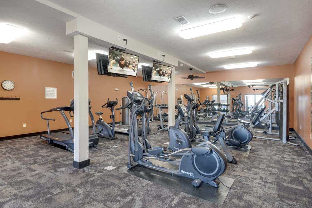 Large fitness center with cardio equipment at The Flats at 84 in southeast Lincoln NE 68516