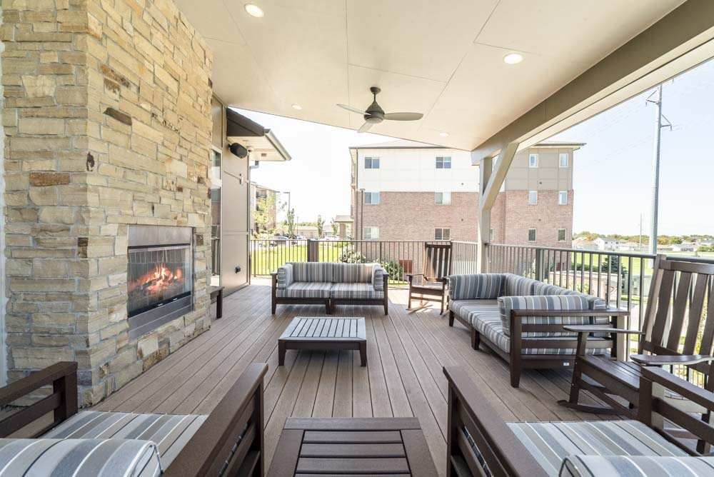 Outdoor lounge with fireplace at The Flats at 84 in southeast Lincoln NE 68516
