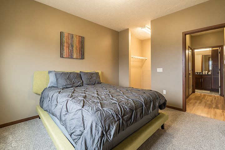 Interiors- Bedroom that easily fits a large bed at The Villas of Omaha at Butler Ridge in Omaha Nebraska