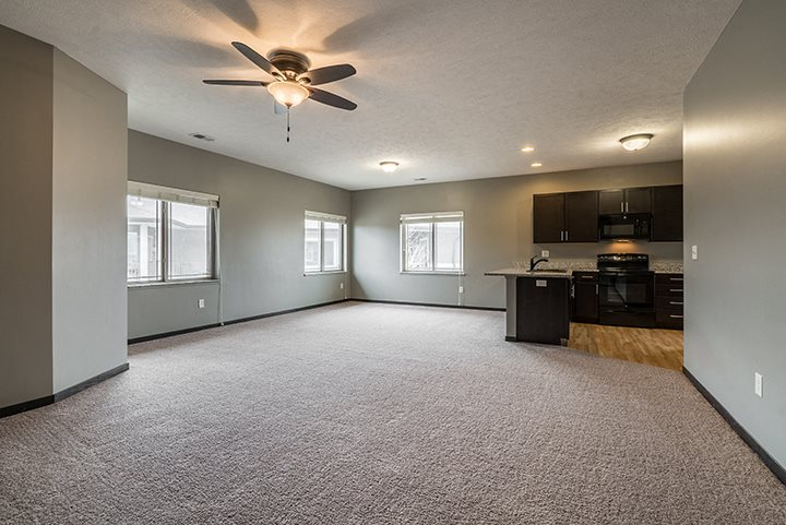 Interiors- Large living space with kitchen at The Villas of Omaha at Butler Ridge in Omaha Nebraska