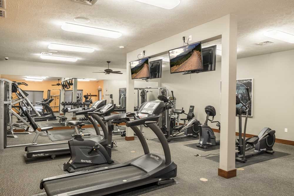 Expansive 24-hour fitness center with cardio equipment, TVs and more at Villas of Omaha townhome apartments in northwest Omaha NE 68116