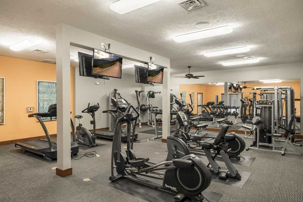 24-hour fitness center with cardio equipment at Villas of Omaha townhome apartments in northwest Omaha NE 68116