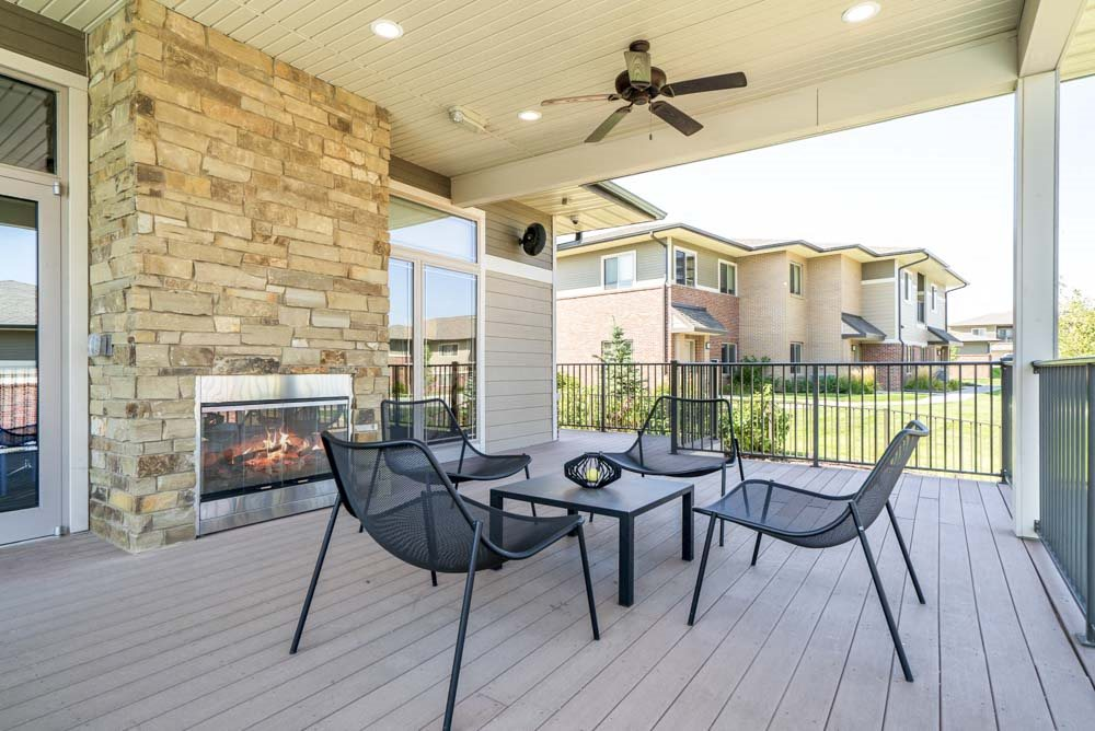 Outdoor fireplace with seating at Villas of Omaha in northwest Omaha NE 68116