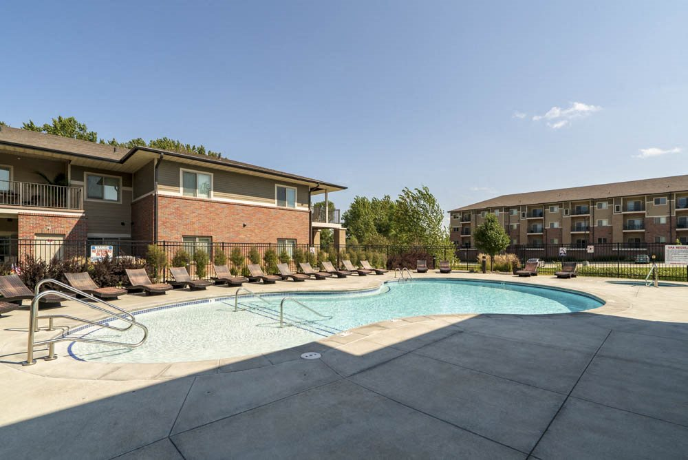 Resort-style pool with lounge chairs at Villas of Omaha in northwest Omaha NE 68116
