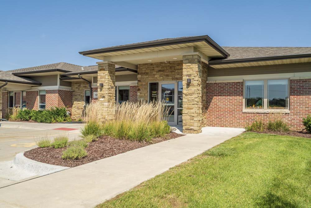 Leasing office entrance at Villas of Omaha townhome apartments in northwest Omaha NE 68116