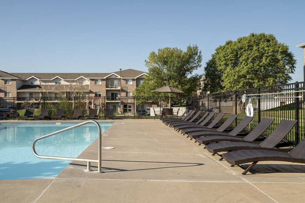 Pool with lounge chairs at Highland View Apartments in north Lincoln NE 68521